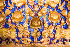Lotus carved gold paint on temple Stock Image