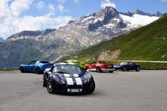 Lotus Elise and Alps landscape. Lotus Elise meeting in Alpine place Royalty Free Stock Photos