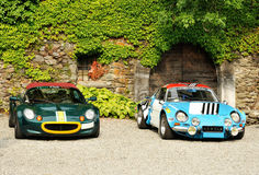 Lotus Elise and Renault Alpine in front of the cas. Lotus Elise and Renault Alpine  parked in front of the castle Royalty Free Stock Photos