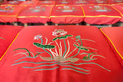 Lotus flower pattern on a red prayer cushion at a Chinese temple Royalty Free Stock Image