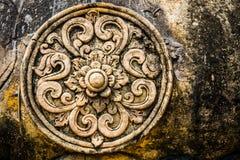 Lotus Flower Stone découpant, symbole antique Photographie stock libre de droits