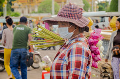Lotus flowers vendor in a crowded market of Phnom Penh, Cambodia. August 30, 2015 Stock Photos