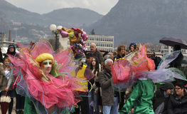 The lotus girls in carnival. Kotor, Montenegro - March 1, 2015. Participants of traditional winter carnival: girls in green and pink costumes of lotus Stock Photos