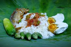 The lotus leaf wrapped rice is the food that the ancient people eat. stock photo