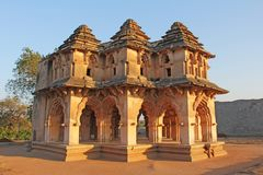 Lotus Mahal Temple in Hampi, Karnataka, India. Beautiful carved. Stone arch and sunset. A popular tourist route from the GOA state. Beautiful hindu temple stock photography
