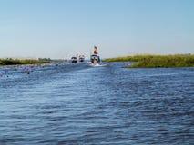 Lotus-Meer und -boot lizenzfreies stockbild