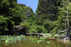 Lotus pond and pedestrian bridge Stock Photography