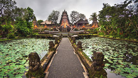 Lotus Pond and Pura Saraswati Temple in Ubud, Bali, Indonesia.  stock photos