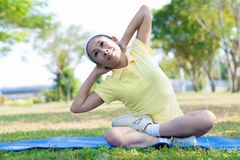 Lotus pose lateral bend Stock Photography