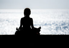 Lotus pose by woman silhouette Stock Images