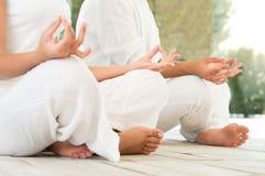 Lotus pose at yoga closeup royalty free stock images
