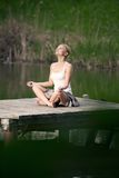 Lotus position. On the lake Royalty Free Stock Images