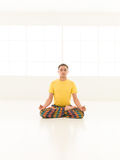 Lotus position studio man Stock Photo