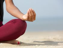 Lotus position with yoga hands Royalty Free Stock Photos
