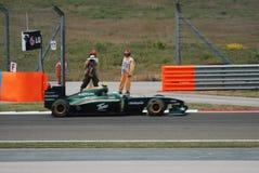 Lotus Racing Team car. Heikki Kovalainen drives a Lotus Racing Team car Royalty Free Stock Image