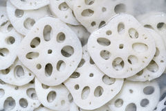 Lotus root. The backrgound of dissected lotus root Royalty Free Stock Image