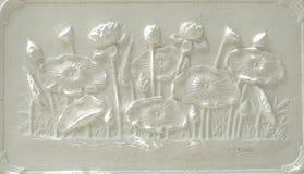 Lotus stucco relieft. White lotus stucco on the wall Stock Image