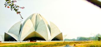 Lotus temple. Delhi, India. Photo about religion, The building is composed of 27 free-standing marble-clad `petals` arranged in clusters of three to form nine royalty free stock photos
