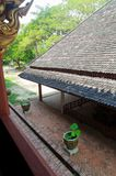 Lotus in water basin under old roof tile Royalty Free Stock Images