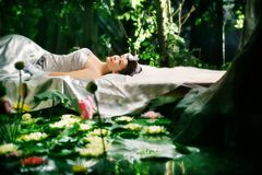 Lotus woman Stock Photo