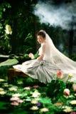Lotus woman Stock Image