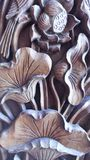 Lotus Wooden. Lotus carved wooden sculpture shaped like the real thing. Thailand pattern engraved by art class. The lotus flower is commonly used to worship Stock Photography