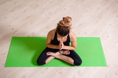 Lotus yoga position from above Royalty Free Stock Photo