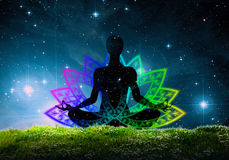 Lotus yoga position Stock Images