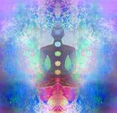 lotusblommar poserar yoga Padmasana med kulöra chakrapunkter Arkivfoto