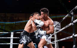 Lou Jim of China and Jean Nascimento of Brazil in Thai Fight Proud to be Thai Royalty Free Stock Photos