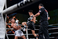 Lou Jim of China and Jean Nascimento of Brazil in Thai Fight Proud to be Thai Royalty Free Stock Images