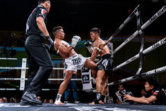 Lou Jim of China and Jean Nascimento of Brazil in Thai Fight Proud to be Thai Stock Photos