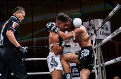 Lou Jim of China and Jean Nascimento of Brazil in Thai Fight Proud to be Thai Stock Image