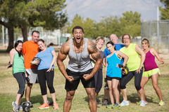 Loud Boot Camp Fitness Trainer. And scared group Stock Photos