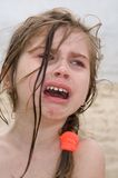 Loud crying. Little pretty girl crying on the beach Royalty Free Stock Photos