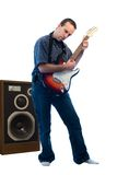 Loud Music. A young man playing loud music on an electric guitar Royalty Free Stock Images