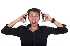 Loud music on headphones Royalty Free Stock Photography