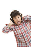 Loud Music. Young boy listening to Loud Music Royalty Free Stock Photo