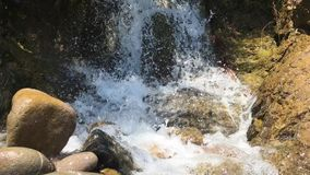 Waterfall sounds. Loud and rich sounds of water flowing over the rocks in the waterfall stock footage