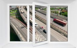 Loud road traffic noise immission from driving cars in opened frame of pvc window. Loud road traffic noise immission from driving cars in opened one frame of pvc royalty free stock photos
