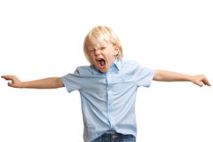 Loud, screaming young boy. A loud and screaming young boy playing or trying to get attention royalty free stock image
