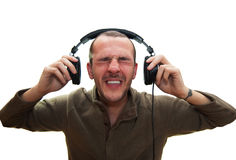 Loud sound. Man has enough from real loud music Stock Photography