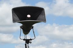 Loud Speaker. A loud speaker set up in a camp against a blue sky Royalty Free Stock Image