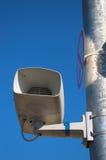 Loud Speaker. A loud speaker is on a railway station on a blue sky Royalty Free Stock Photo