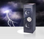 Loud speaker against night sky with thunderbolt Stock Image