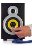 Loud speaker and hand. Male hand, phonendoscope Stock Photos