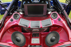Loud Stereo. A loud stereo in the back of a car with speakers, amplifiers and monitors royalty free stock photos