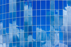 Сlouds and blue sky reflected. Royalty Free Stock Photography