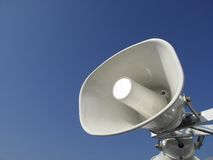 Loudspeaker. White loudspeaker for anouncements with blue sky in background Stock Images