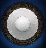 Loudspeaker. On a dark blue background Royalty Free Stock Photo